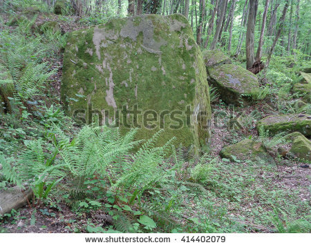 ancient stone pyramid in caucasian forest